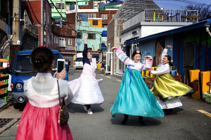 women dancing in the street