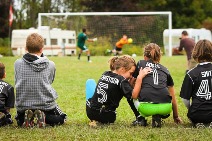A soccer player is nervous as her team takes penalty shots - capture mood