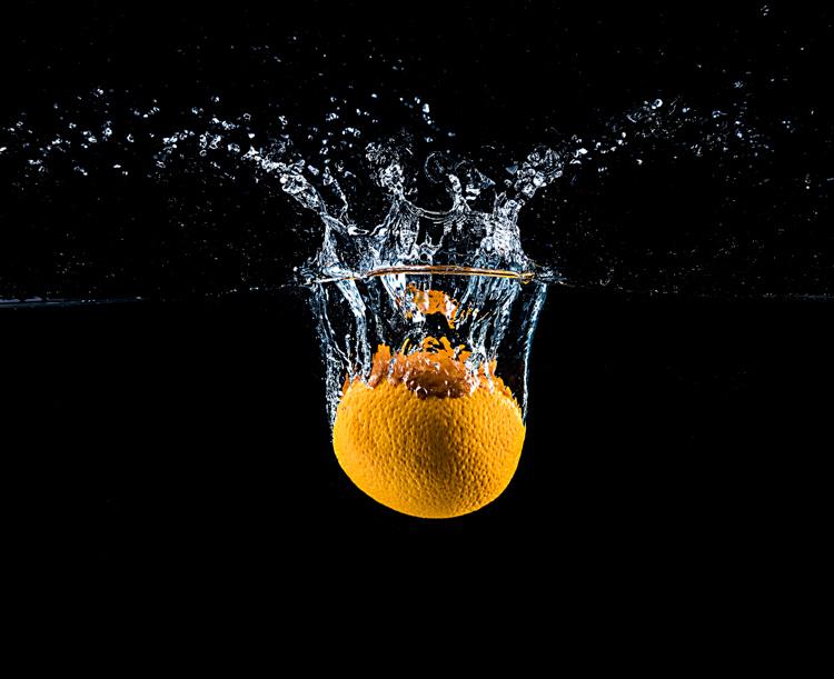 orange water splash photography