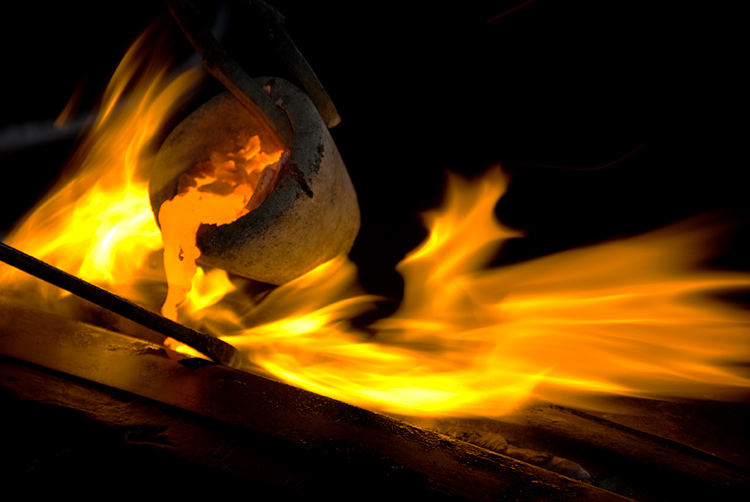 Bronze Being Poured From A Small Crucible surrounded by flames - 5 Key Elements that Directly Impact the Quality of Your Photography
