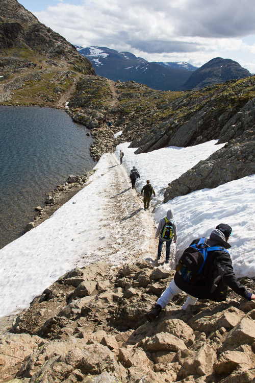 A group of hikers photographed using leading lines to show distance - How to Show a Sense of Scale in Your Photography
