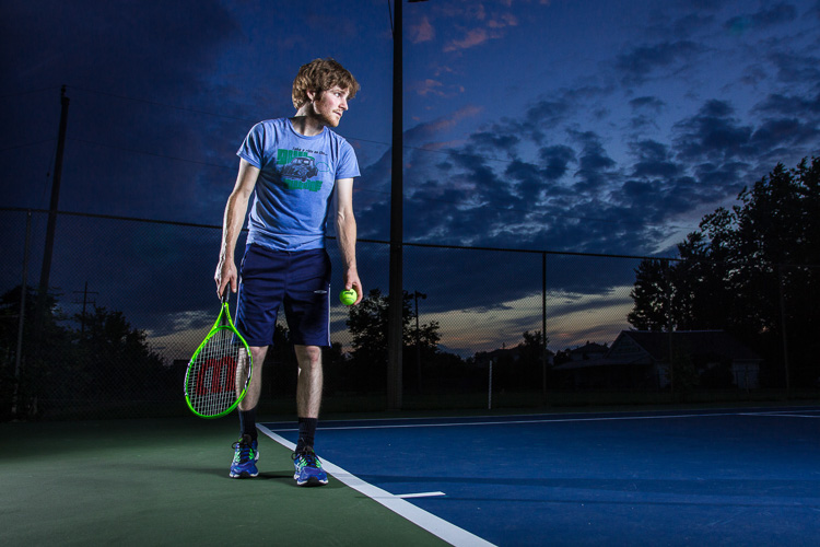 A tennis player lit by off-camera flash cross lighting