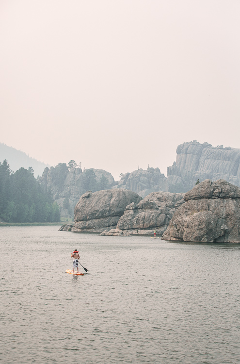 Custer State Park Paddle boarding in Lake Custer - Rocking the Photography Equipment You Currently own Versus Buying New Gear