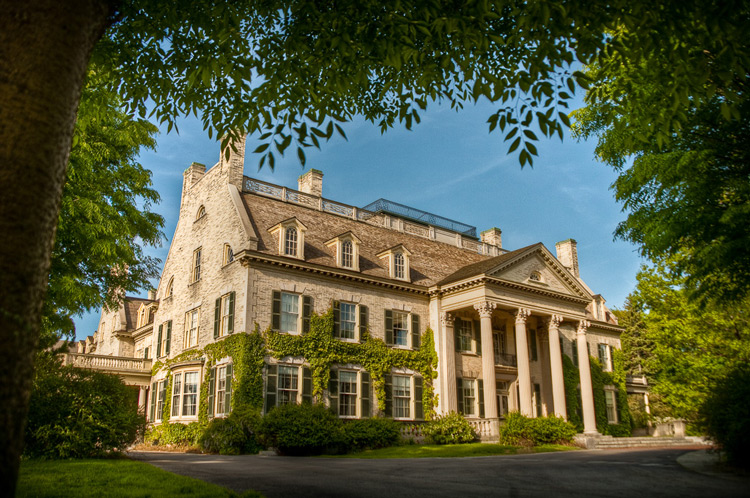 Image: Eastman Kodak House (the home of George Eastman who founded Kodak) framed by the trees in the...