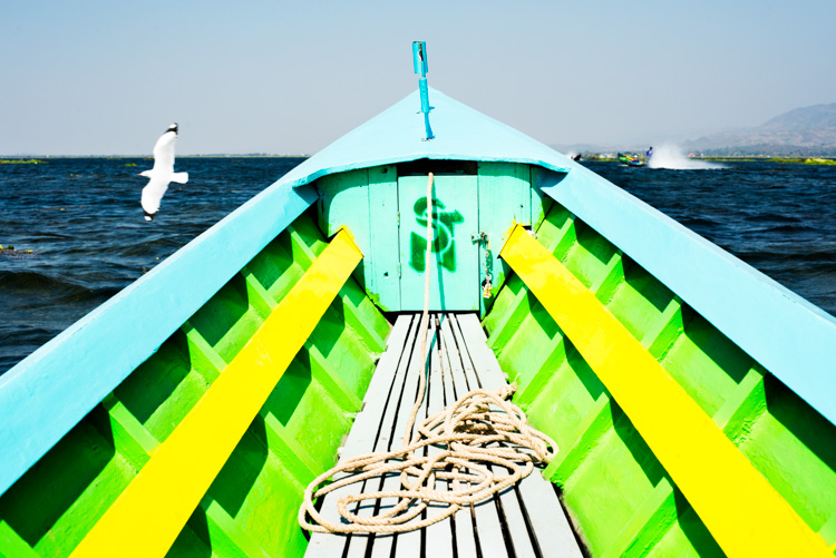 blue yellow and green painted boat on the water. 3 Bad Habits to Break to Improve Your Photography