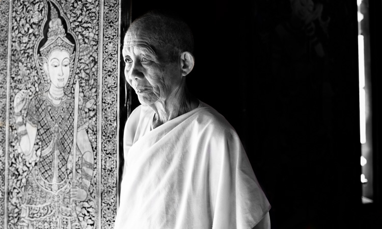 Buddhist nun standing at the temple window - 3 Key Tips for Making More Dynamic Photographs