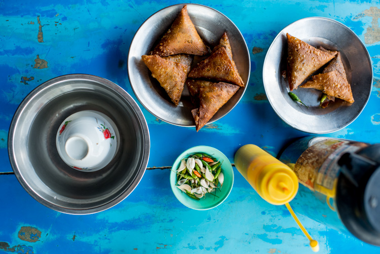 Snacks on a blue table in Myanmar. - 3 Bad Habits to Break to Improve Your Photography
