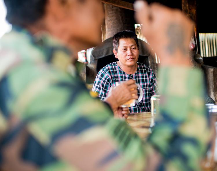 men sitting having breakfast in a market in Myanmar - 3 Bad Habits to Break to Improve Your Photography