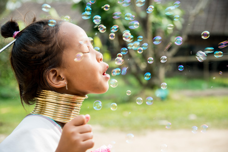 Kayan girl having fun playing with soap bubbles. - 3 Key Tips for Making More Dynamic Photographs