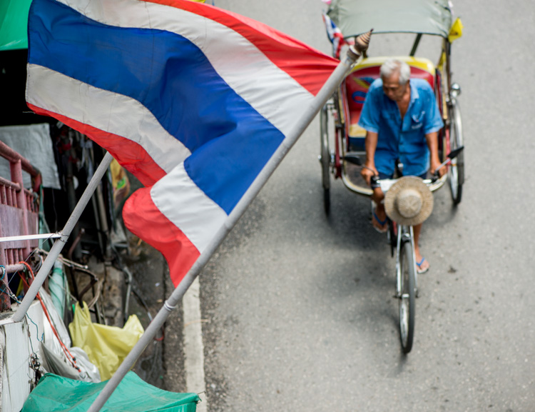 Looking down at a Tricycle Taxi Rider in Chiang Mai, Thailand, With a Thai flag - 5 Tips To Help You Enjoy Your First Digital Camera
