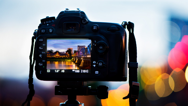 back of a DSLR camera showing the image of the Iron Bridge in Chiang Mai, Thailand, on the monitor - 5 Tips To Help You Enjoy Your First Digital Camera