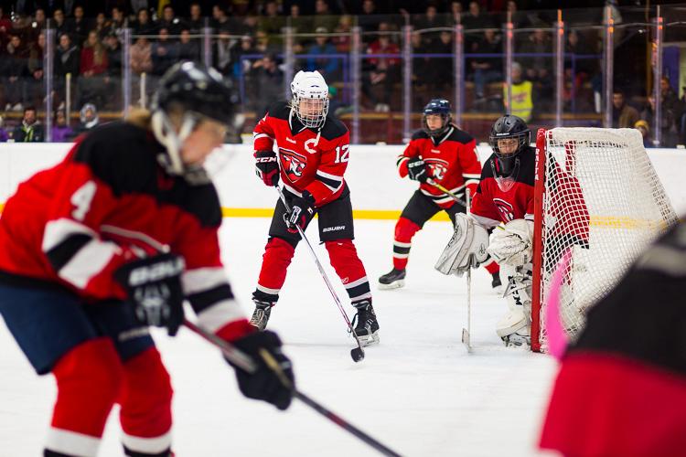 Hockey players wearing bright red hockey jerseys - Tips for Editing Hockey Photos in Lightroom