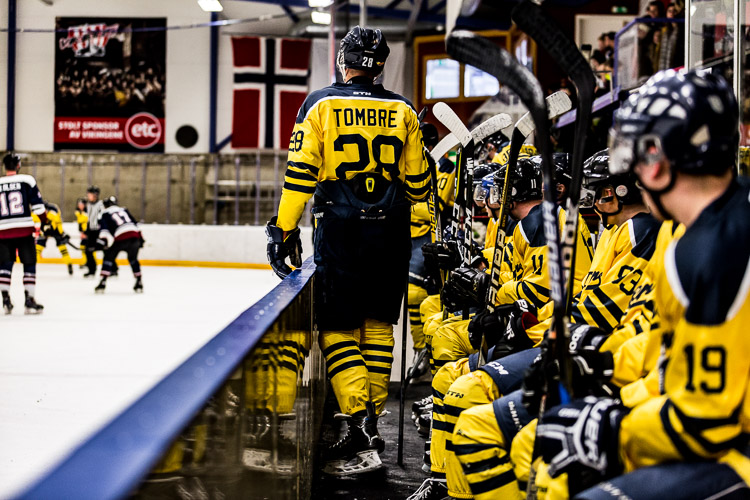 A hockey player on the bench, with clarity heavily applied