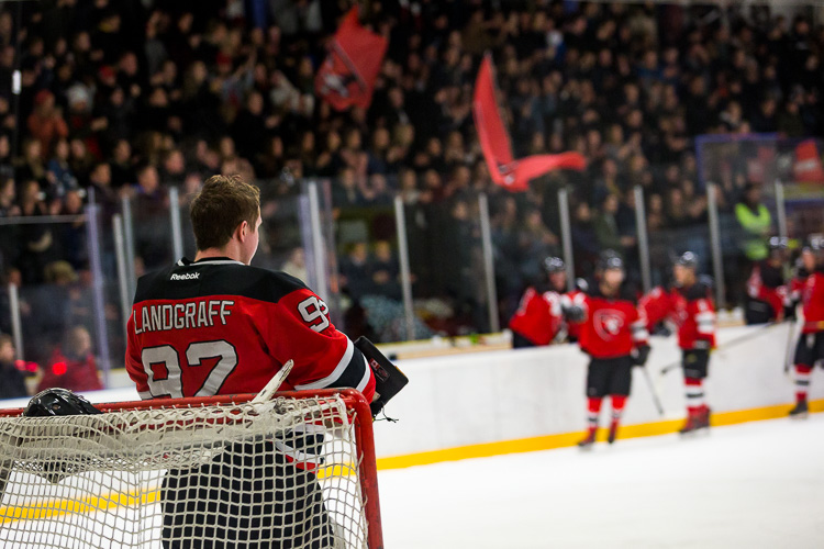 An unbalanced image of a hockey goaltender - Tips for Editing Hockey Photos in Lightroom