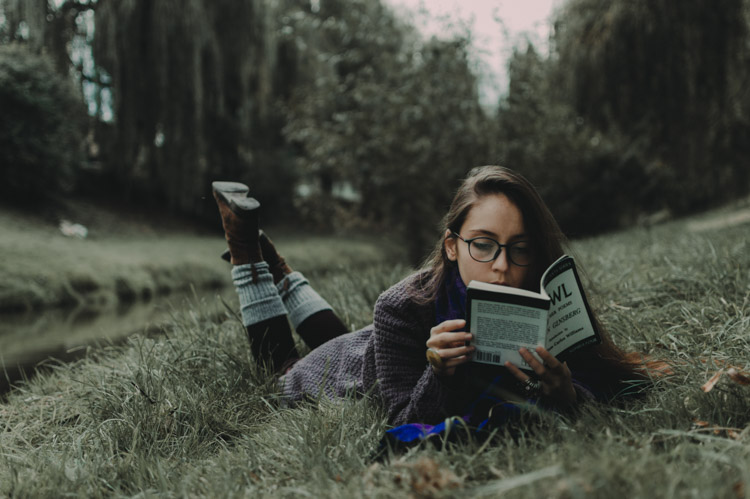 girl reading in the grass - What keeps you from taking better photos, your EQUIPMENT or your KNOWLEDGE?
