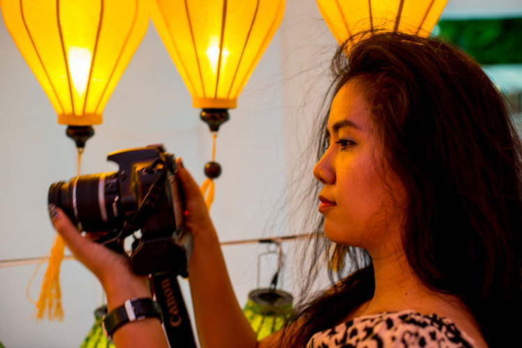 Asian woman photographer 4 Tips to Help You Love Using Manual Mode