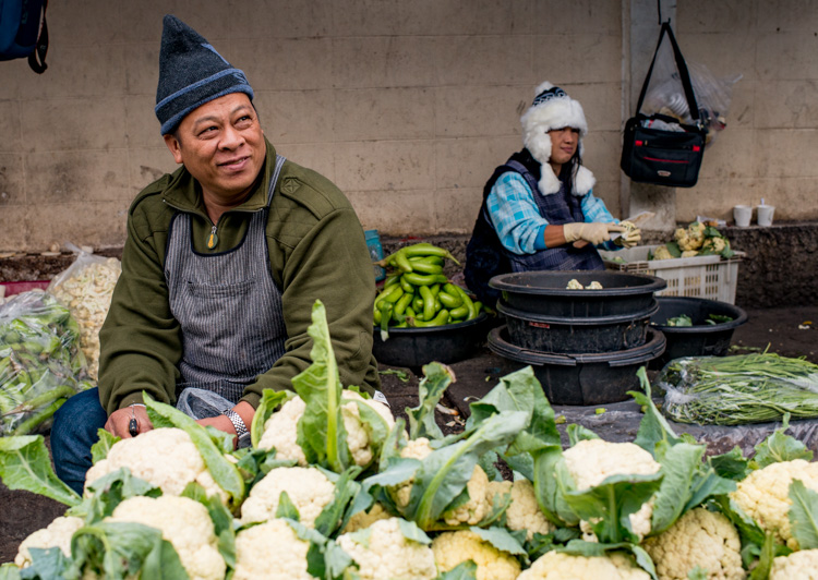 vegetable vendors at a street market - better background