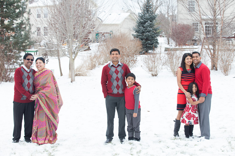 Spot coloring in photography - family portraits in red colored clothes against the snow