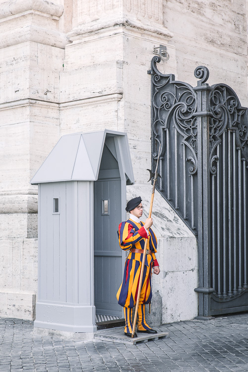 Spot coloring in photography - roman vatican guard in costume standing guard