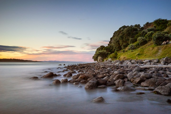 Long exposure landscape photo of rocks at sunset, Mt Maunganui, New Zealand - photography portfolio