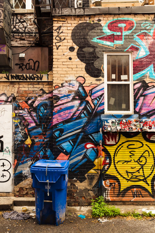 Tips for Packing for Travel Photography - garbage can in an alley with graffiti