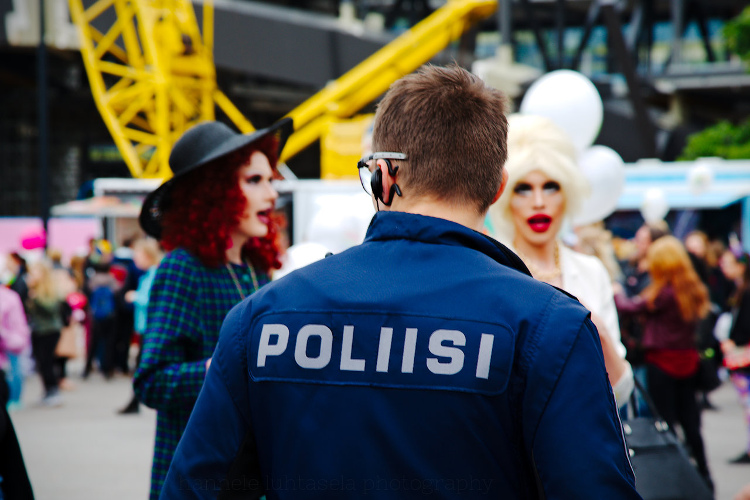 How to Use Conceptual Contrast in Photography - police and people dressed up