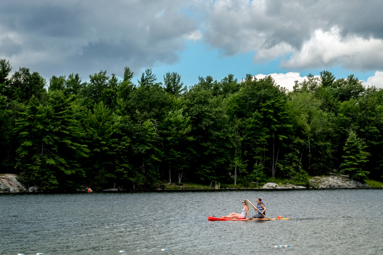 two girls paddle boarding - How Conquer Your Fear of People as a Photographer