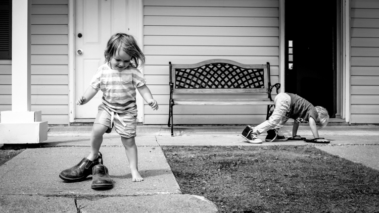 Kids playing with their parents shoes. How to Photograph Your Family Vacation