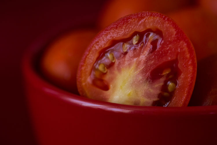 Tips for Using Color in Your Photography - red tomato in a red bowl