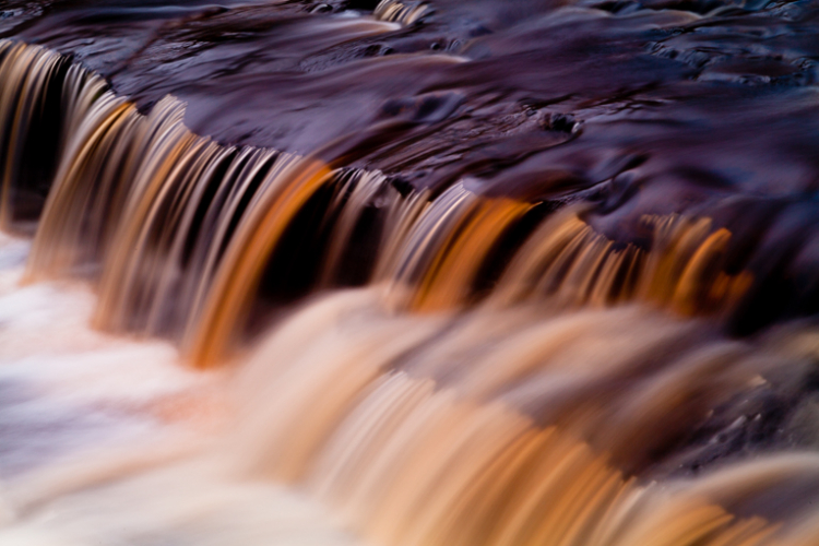 7 Reasons Why a Tripod is Must for Outdoor Photographers - image of water flowing in a river or stream