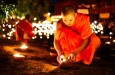 Night photo of a buddhist monk at a ceremony at Wat Pan Tao taken during a Chiang Mai Photo Workshop
