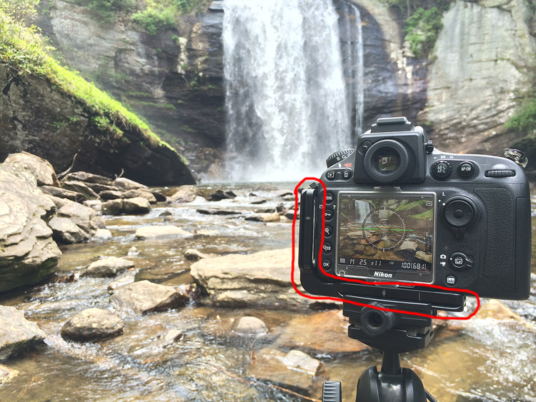Why I Always Use an L-Plate Bracket for Landscape Photography - camera mounted on a tripod with an l-plate bracket