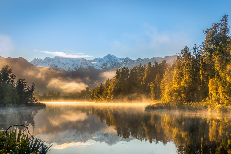 What Makes Great Photos? 5 Factors That Can Take Your Images From Good to Great - sunset photo of fog over a mountain pond