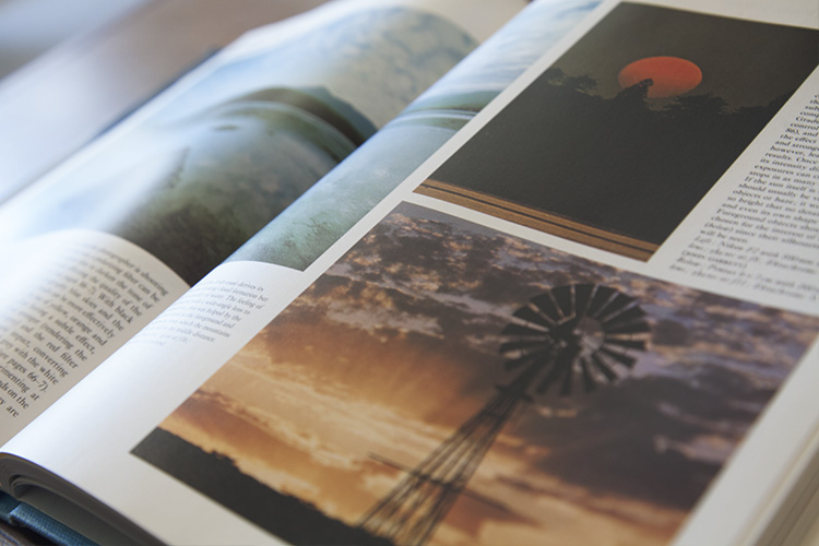 an open book with photos inside - Why Old Photography Books and Magazines are Still Valuable