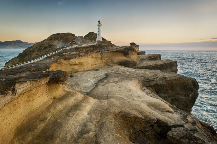 How to Improve Your Landscape Photography By Understanding Portrait Lighting - lighthouse on a rocky shoreline