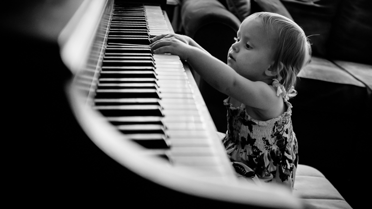 A little girl playing the piano.