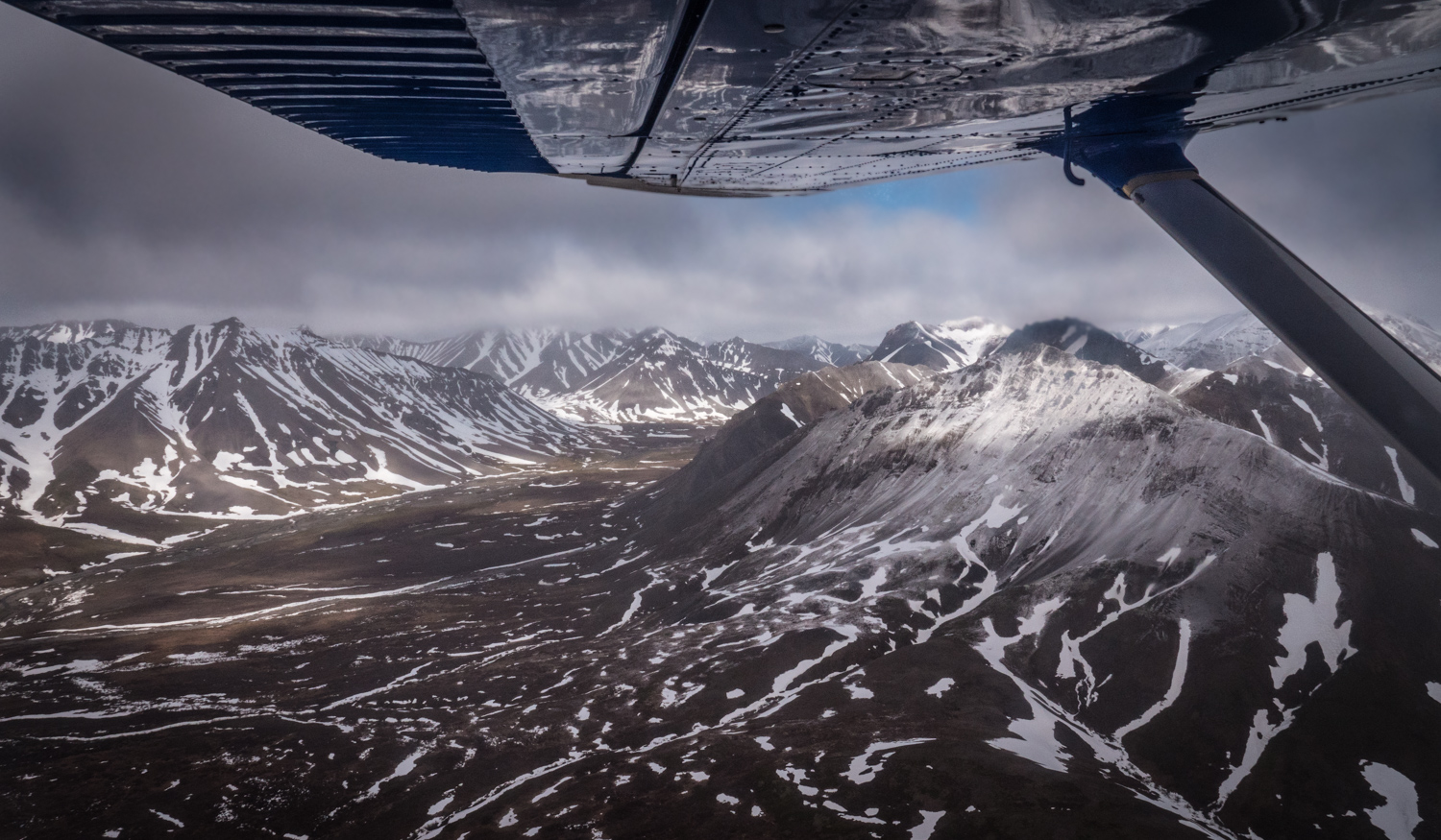 cloudy view of mountains from a small plane - Five (More) Uncomfortable Truths About Photography