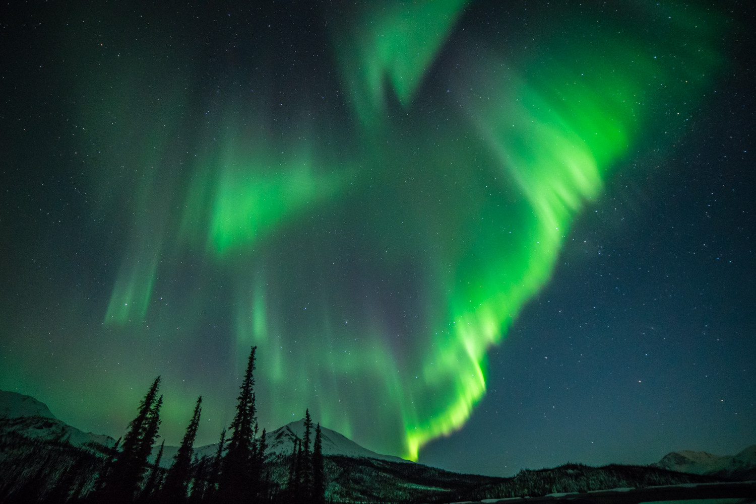northern lights over a mountain scene - Five (More) Uncomfortable Truths About Photography