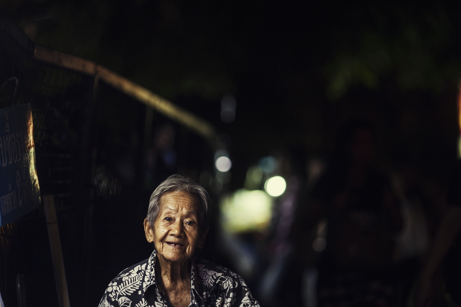 Five Essential Shots You Need to Get for Street Market Photography - low key portrait of a lady