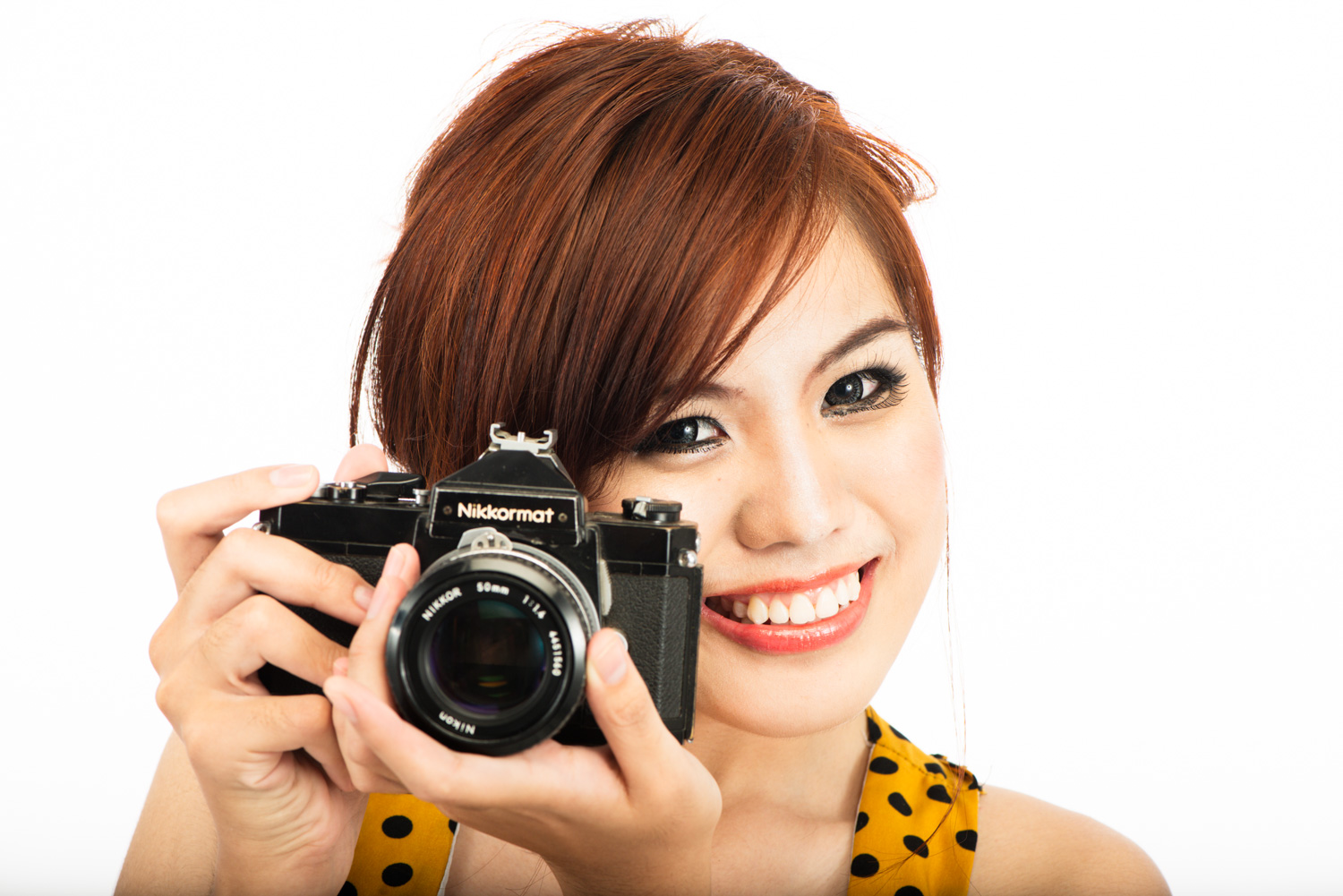 Portrait of an Asian woman with a Nikkormat FTN film camera - 4 Tips to Help You Overcome the Fear of Photographing People