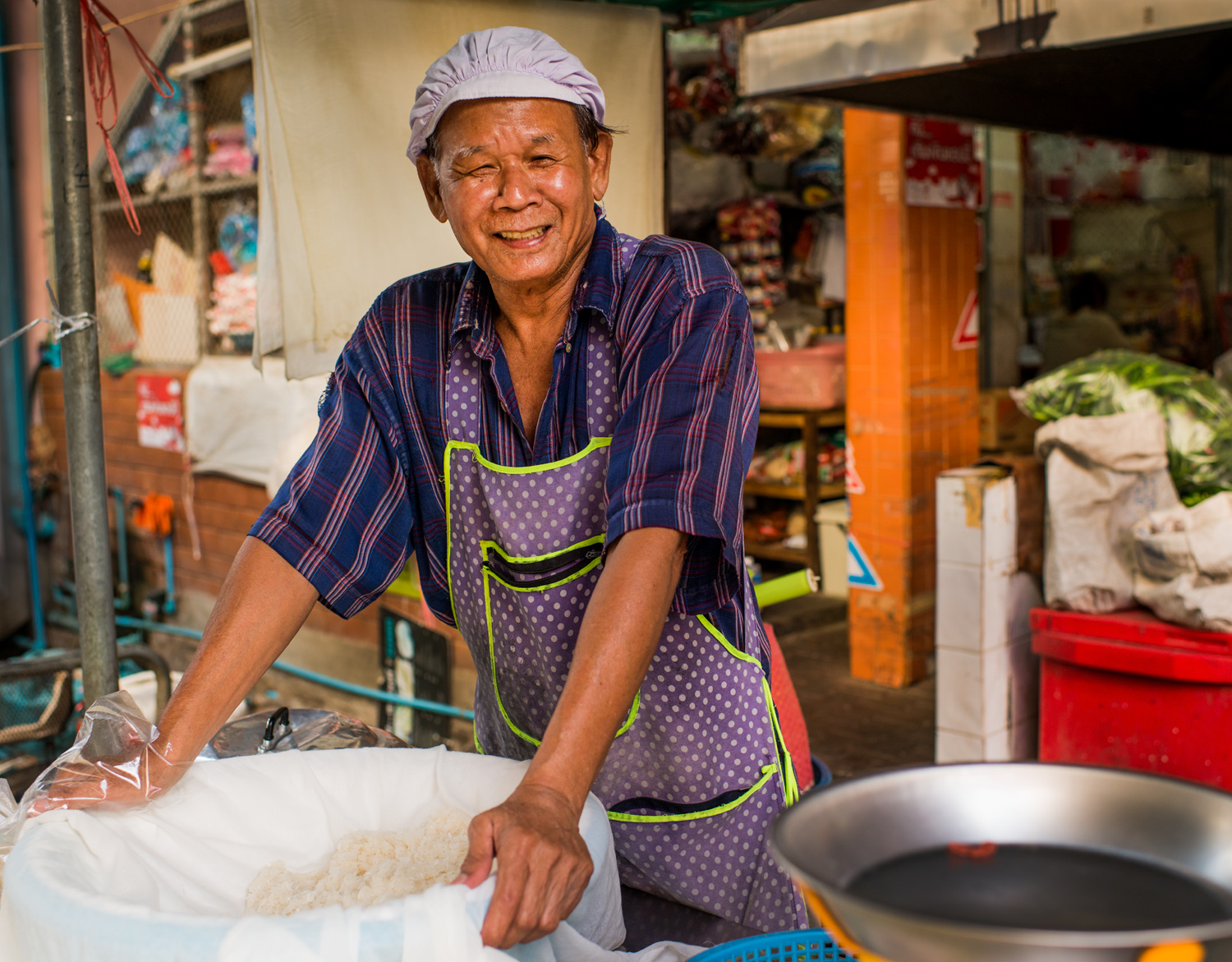Portrait of a rice vendor at Muang Mai Market - 4 Tips to Help You Overcome the Fear of Photographing People