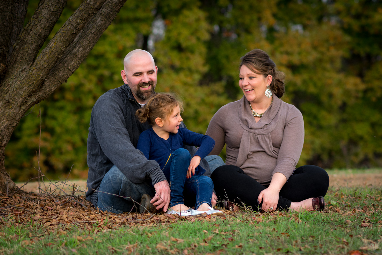 family sitting on the grass - 5 Crucial Mistakes You Need to Avoid When Photographing Clients