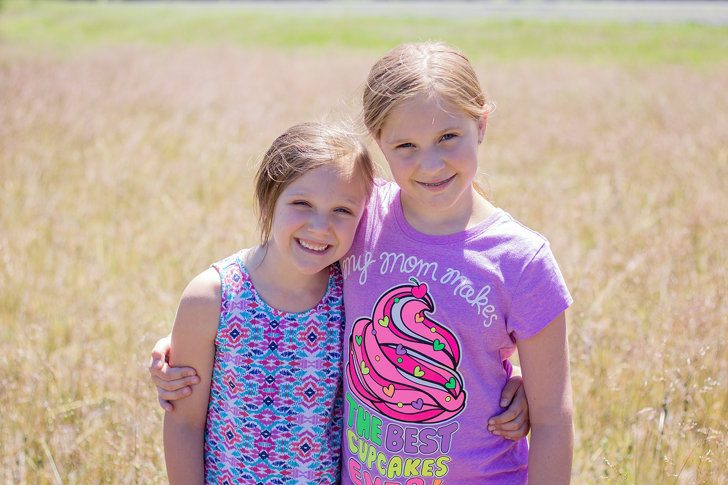 two girls backlit by the sun - 3 Tips For Photographing Kids in Harsh Light