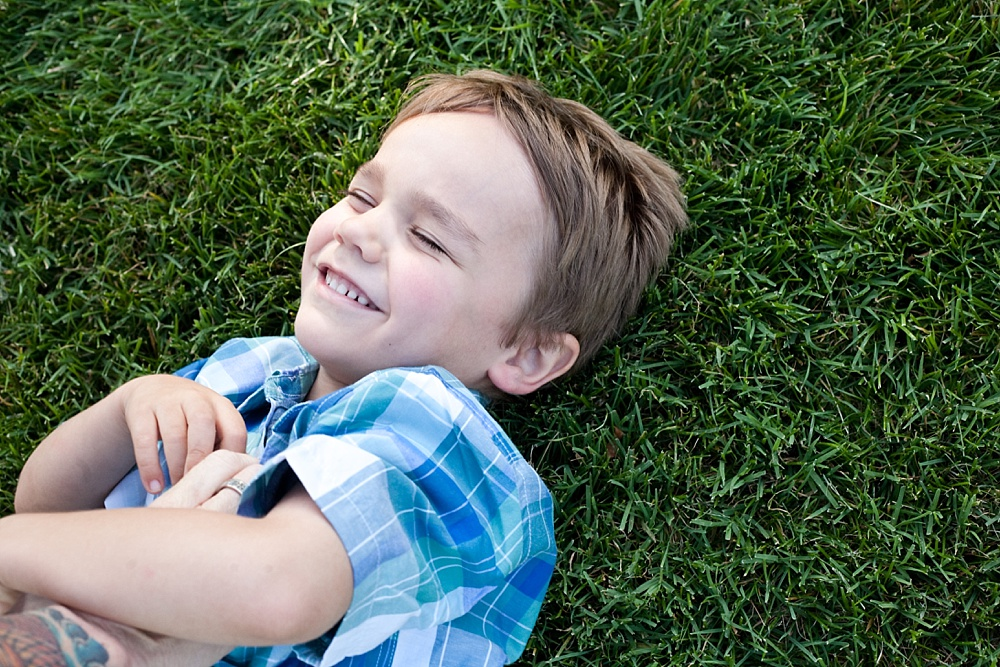 How to Survive Portrait Sessions with Difficult Children - boy in the grass
