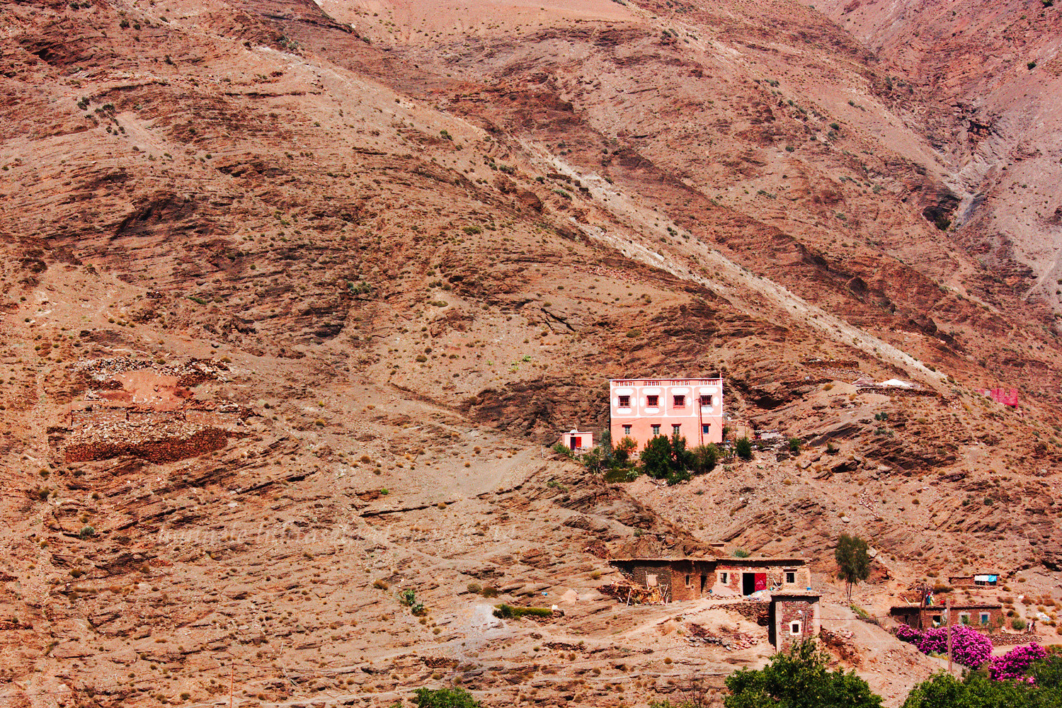 A house seen from a car in the Rif mountains of Morocco. Tips for Taking Better Pictures from a Moving Vehicle