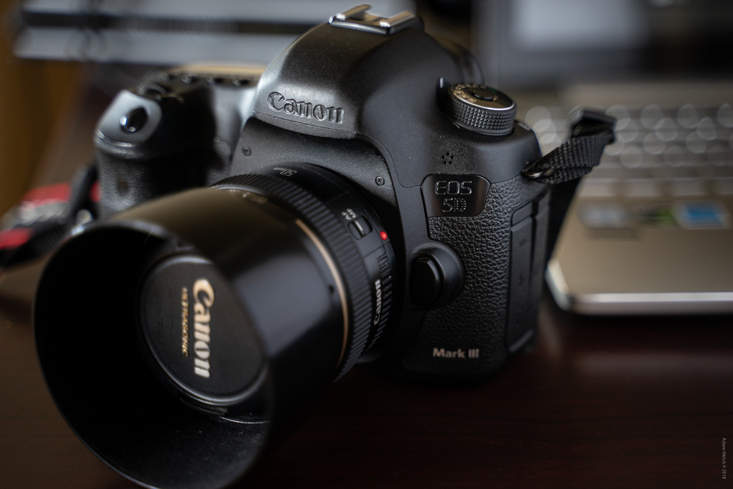 Canon camera and 50mm lens - Mobile Phones Versus DSLRs