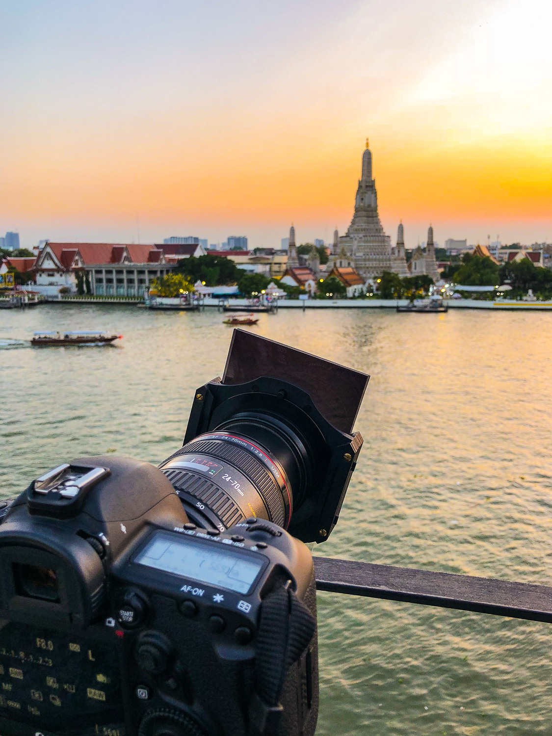 Canon camera with filter on the lens - The First 10 Things You Need to Buy After Your Camera for Travel Photography