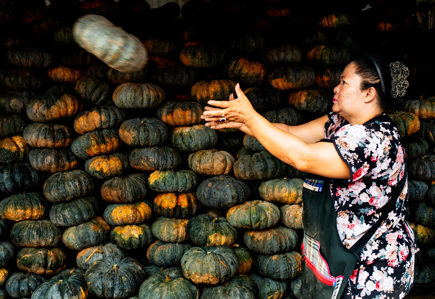 woman catching a pumpkin - Tips for Culling Your Photos