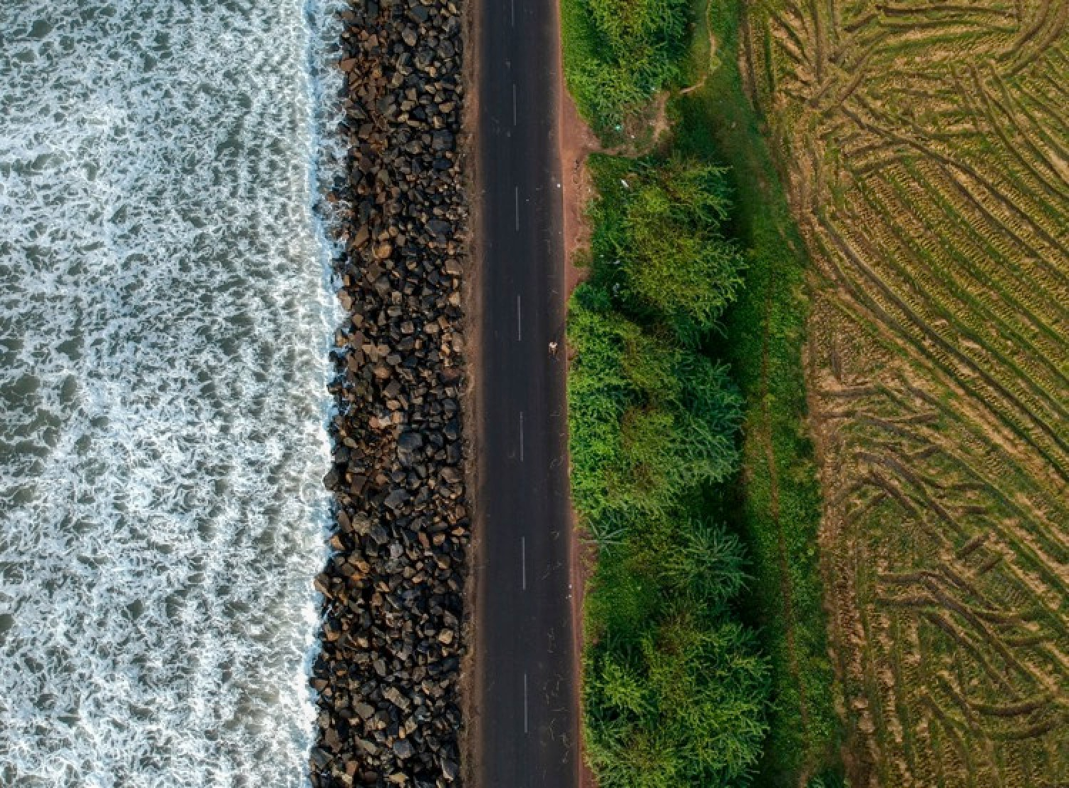 Six Non-Photography Tips to Super-Charge Your Travel Photography - overhead shot of a road and field