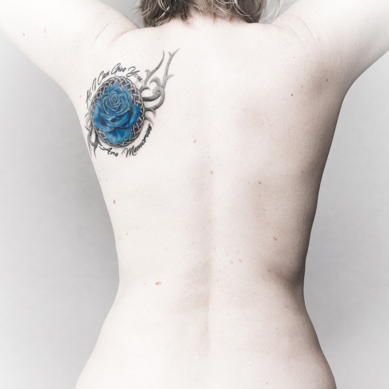 Tips to Get the Best Out of a Model Shoot - bare back with tattoo
